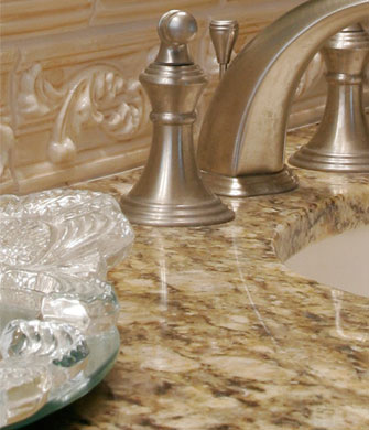 Close up of granite counter tops and brushed nickel fixtures