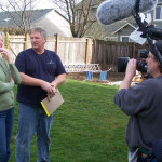Photo of John and Homeowner talking in front of the cameras.
