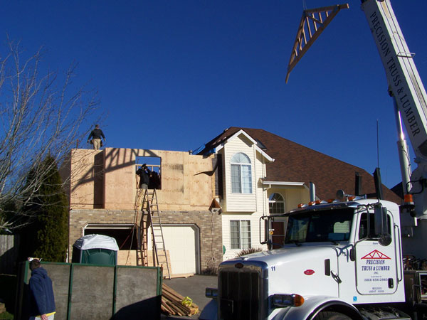 Photo of the exterior house as the second story addition is being built.