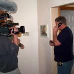 Photo of John Sramek being filmed as he calls a subcontractor