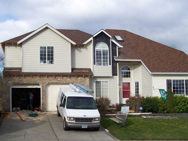 Photo of exterior of second story addition. It has been roofed and sided and blends seamlessly with the rest of the house.