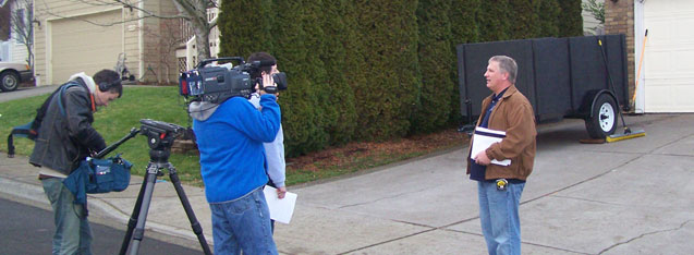 Photo of John Sramek being filmed for New Spaces TV show in front of second story addition project in Sherwood Oregoni