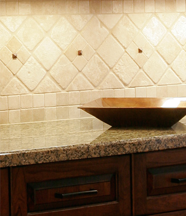 Close up of tile backsplash and granite countertops in remodeled kitchen