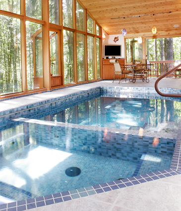 Tiled hot tub and pool in cedar pool room addition