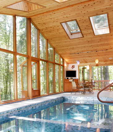 Pool, glass wall on right, and cedar ceiling of pool room addition