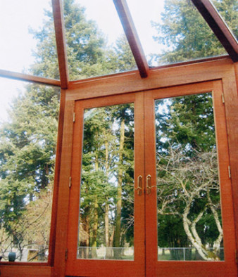 Close up of cedar framing around glass wall sections of sunroom addition