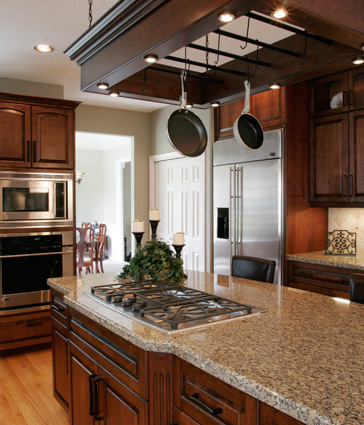 Kitchen with dark wood cabinets and stone countertops
