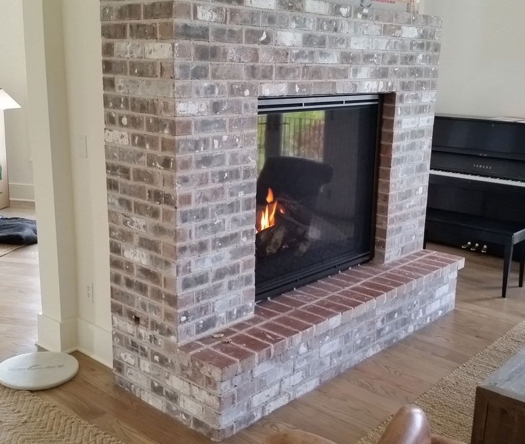 Large brick fireplace open in two directions